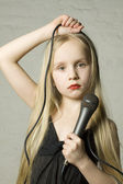 Pretty blond girl with microphone — Stock Photo