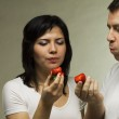 Man and woman eat red strawberry — Stock Photo