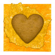 Yellow paper background with cookies heart — Stock Photo