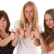 Female students show thumbs up — Stock Photo