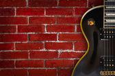 Guitar on grunge background - music — Stock Photo