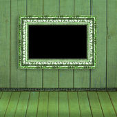 Photo frame hanging on the green blurred wall - old album backgr — Stock Photo