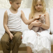 Stock Photo: Children with kitten in daylight at home