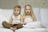 Happy children read a book — Stock Photo