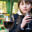 Stock Photo: Cute young womwith wine glass