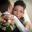 Beautiful bride and groom in indoor setting - Stock Photo