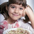 Girl enjoying her lunch — Stock Photo