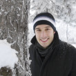 Royalty-Free Stock Photo: Young man smiling in winter park