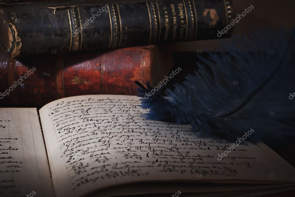 Feather, old books and manuscript on the table — Stock Photo #5087013