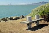 A bench on the seashore — Stock Photo