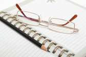 A diary, pencil and glasses — Stock Photo