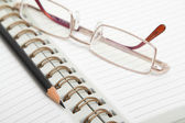 Diary, pencil and glasses — Stock Photo