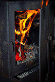 Fire in the furnace — Stock Photo