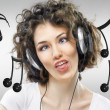 Girl with headphones - Stock Photo