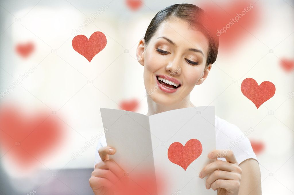Girl with a postcard in his hand — Stock Photo #4915979