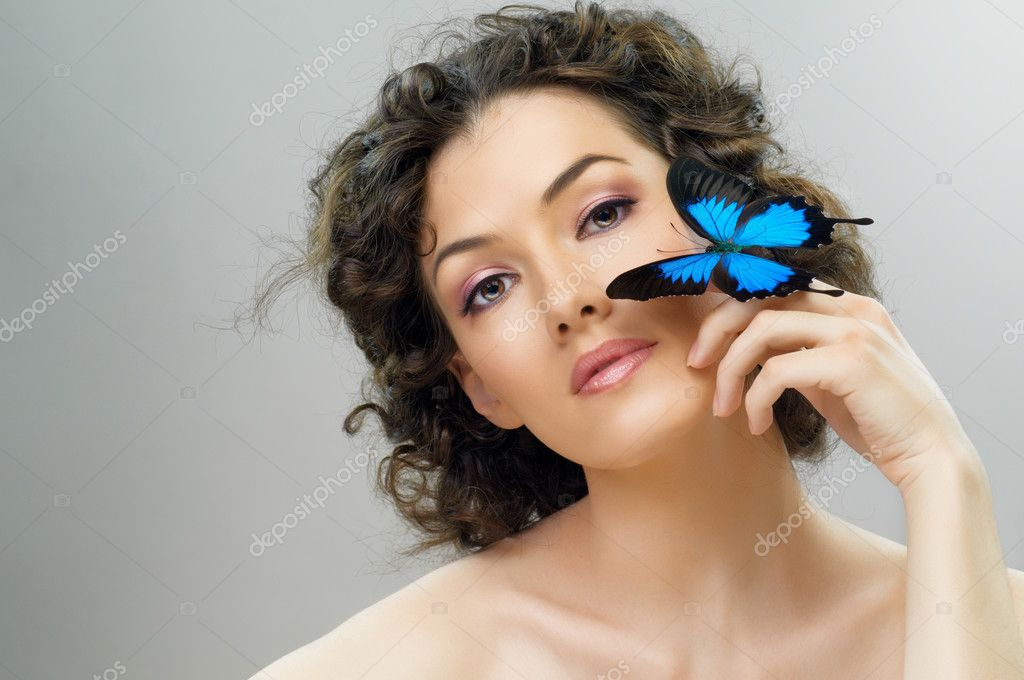 Girl and a beautiful butterfly — Stock Photo #5363765