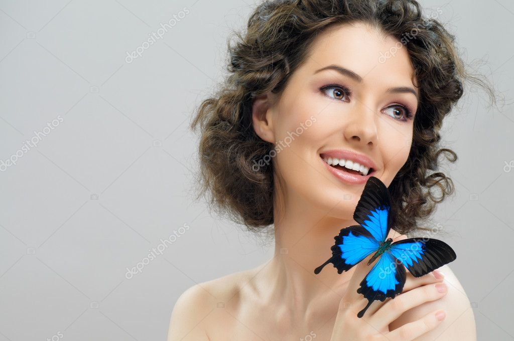 Girl and a beautiful butterfly  Stock Photo #5363775