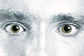Green male eyes with dilated pupil — Stock Photo