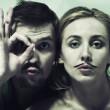 Young man and  woman with  mustache - Stock Photo