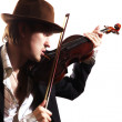Young violinist playing violin in hat and jacket — Stock Photo #4171171