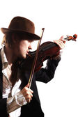 Young violinist playing the violin in hat and jacket — Stock Photo