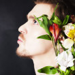 Young man with a bouquet of flowers — Stock Photo