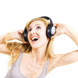 Young woman singing with headphones isolated — Stock Photo