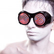 Portrait of a young man with white skin in strange glasses - Stock Photo