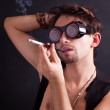 Brunet man with cigarette in the mouthpiece — Stock Photo #4777853