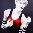 Theatrical mime in white hat and striped gloves — Stock Photo #4777902