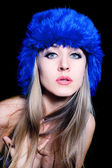 Beautiful young woman in blue winter hat — Stock Photo