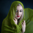 Beautiful young woman in green summer shawl — Stock Photo