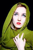 Beautiful young woman in green summer dress — Stock Photo
