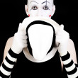 Stock Photo: Mime holding white hat