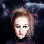 Young woman with bright Gothic makeup — Stock Photo