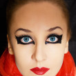 Portrait of beautiful young woman with bright makeup - Stock Photo