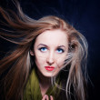 Woman with hair fluttering in wind closeup — Stock Photo #5035205