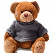 Toy teddy brown bear with patches in green sweater — Stock Photo