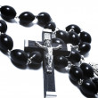 Catholic black wooden beads with metal crucifix — Stock Photo