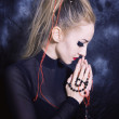 Praying woman with make-up in Gothic style — Stock Photo