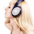 Young woman with headphones — Stock Photo #5138568