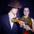 Young man in hat with violin and young woman in veil with bouque — Stock Photo #5158992