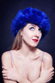 Young woman in blue winter hat — Stock Photo