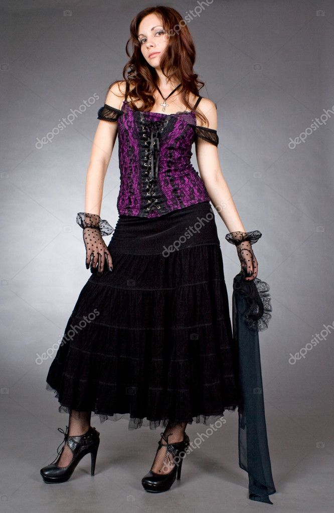Portrait of a gothic girl in a corset in full growth on gray background  Stock Photo #4262118