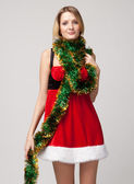 Christmas girl over tinsel — Stock Photo