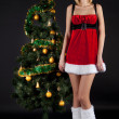 Santgirl with christmas tree — Stock Photo #4361324