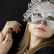 Stock Photo: Beautiful womwith mask in face of