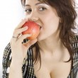 Stock Photo: The beautiful young woman eats an apple