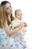 Careful mother dresses the daughter — Stock Photo
