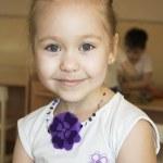 Shy little girl in a kindergarten. — Stock Photo #5250727